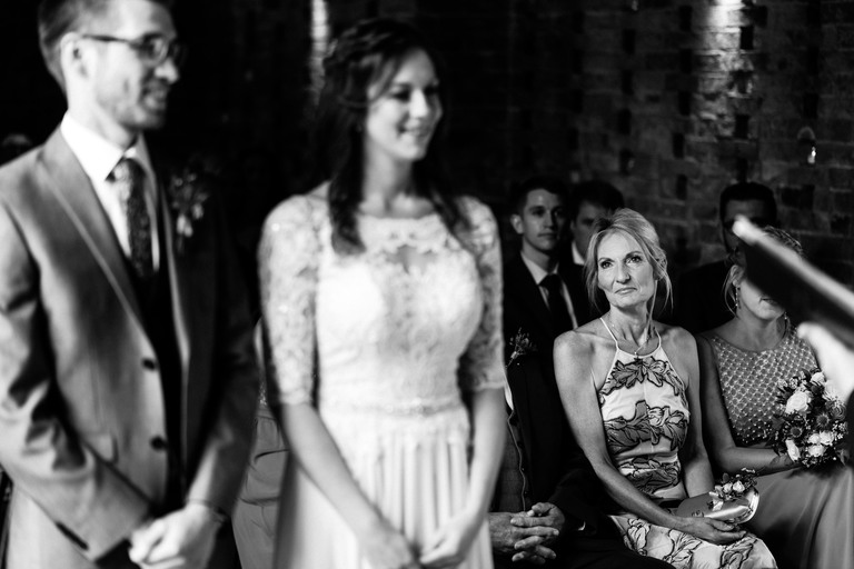 mother of the bride looking on during ceremony