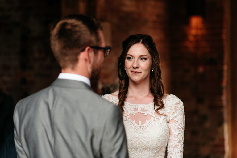 bride looking at her husband during ceremony