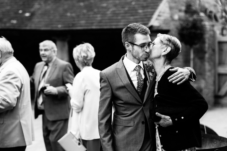 groom sharing a moment with his aunt