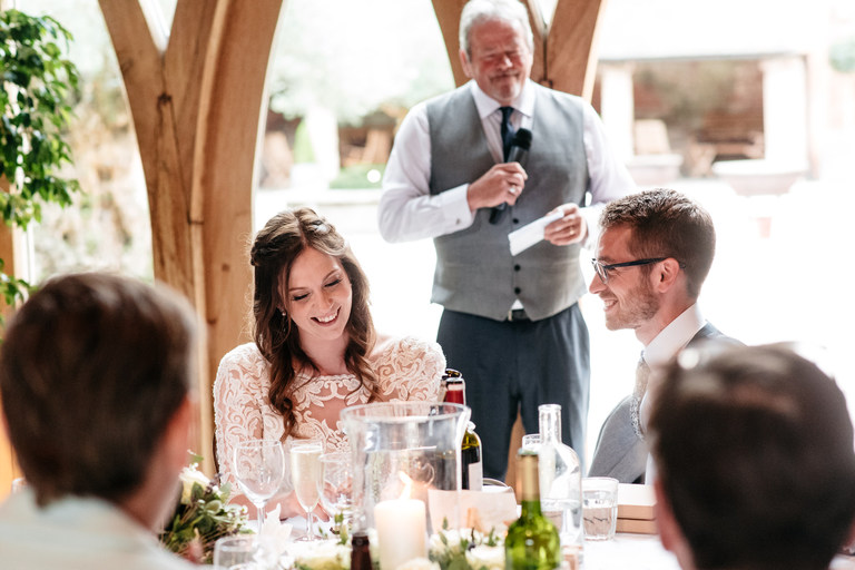 happy faces during father of the bride's speech