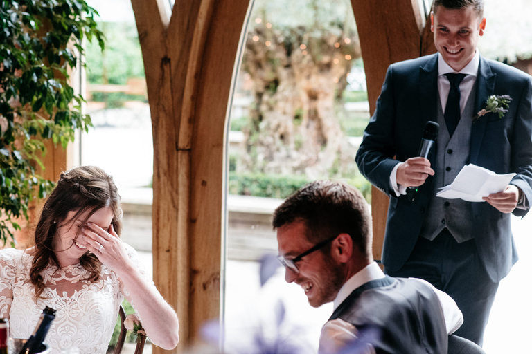 embarrassed bride during best man's speech