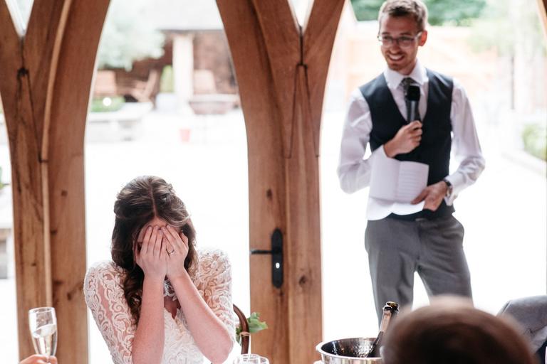 bride with her head in her hands