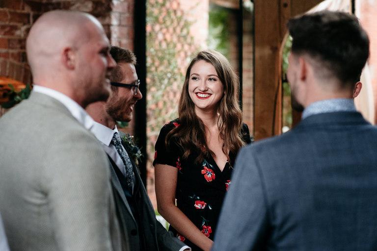 smiling female wedding guest