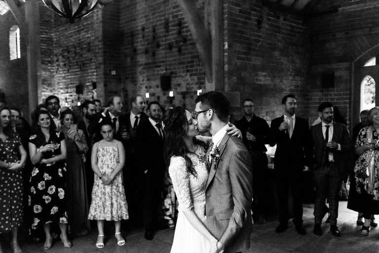 couple kissing during first dance