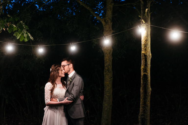 night time wedding portraits underneath lanterns