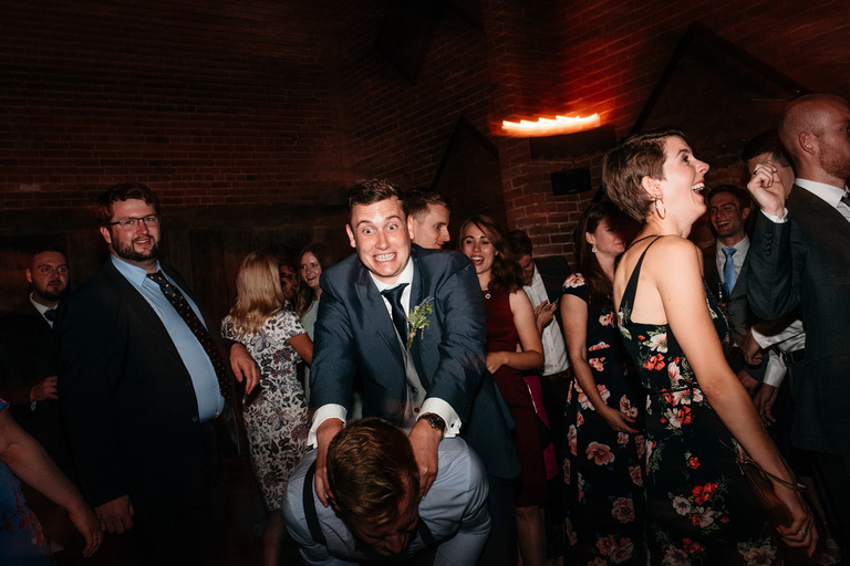 two guys messing around on the dance floor
