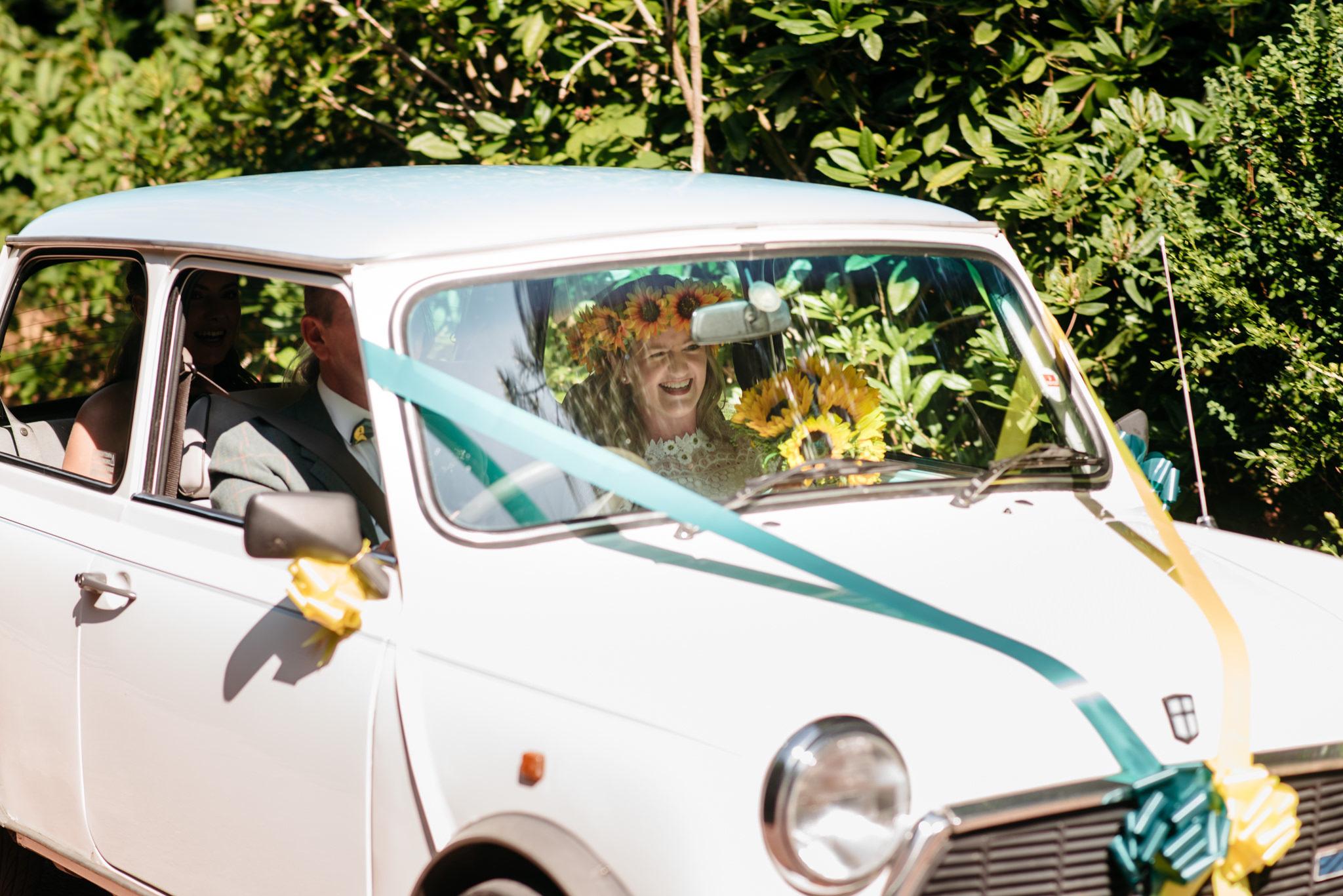 bride arriving in vintage mini