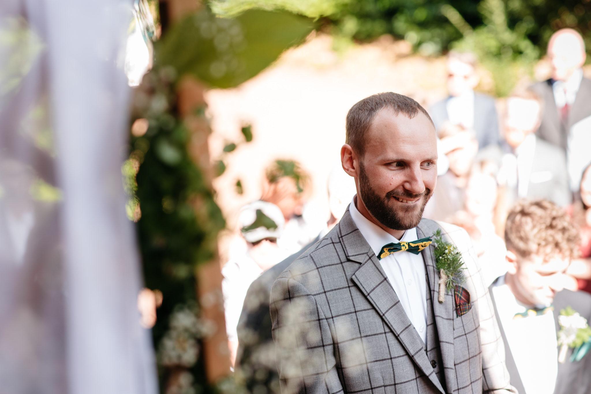 groom wearing vintage inspired suit