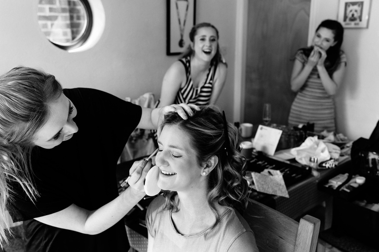 bride makeup with bridesmaids laughing