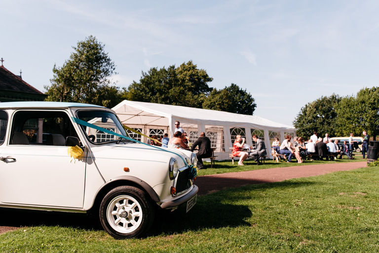 vintage mini at an outdoor festival wedding
