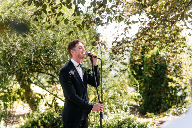 bride's brother singing outdoors