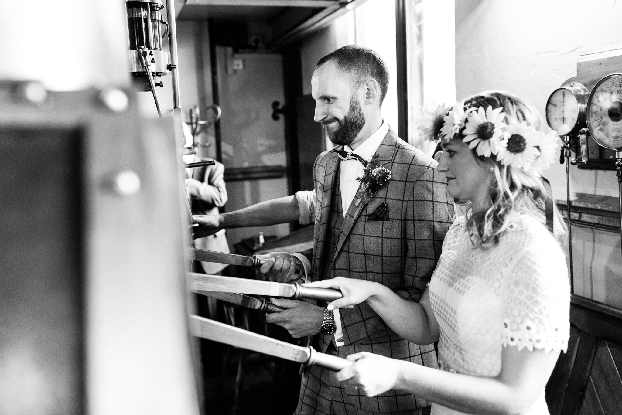 bride and groom starting up the engine at papplewick pumping station