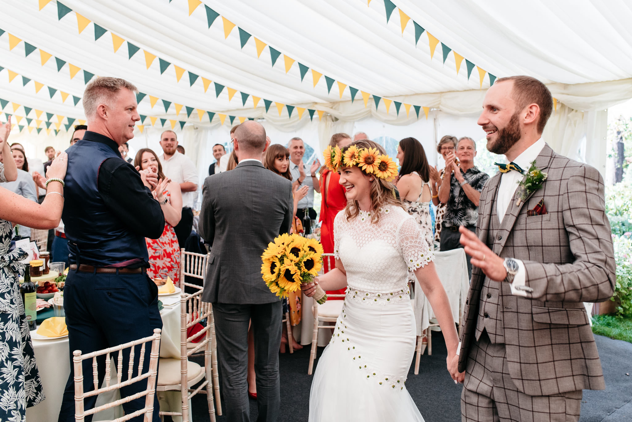 couples entrance to their marquee festival wedding