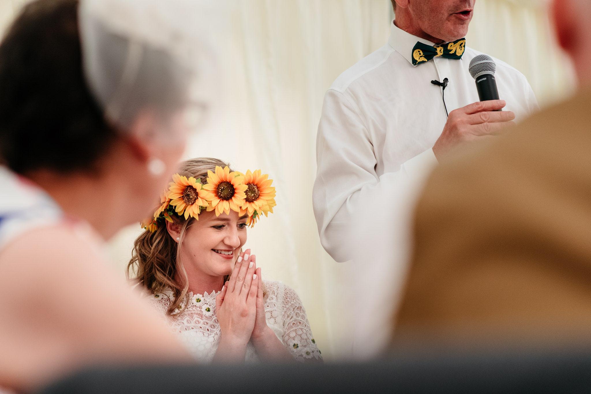 thoughtful bride wearing sunflower crown