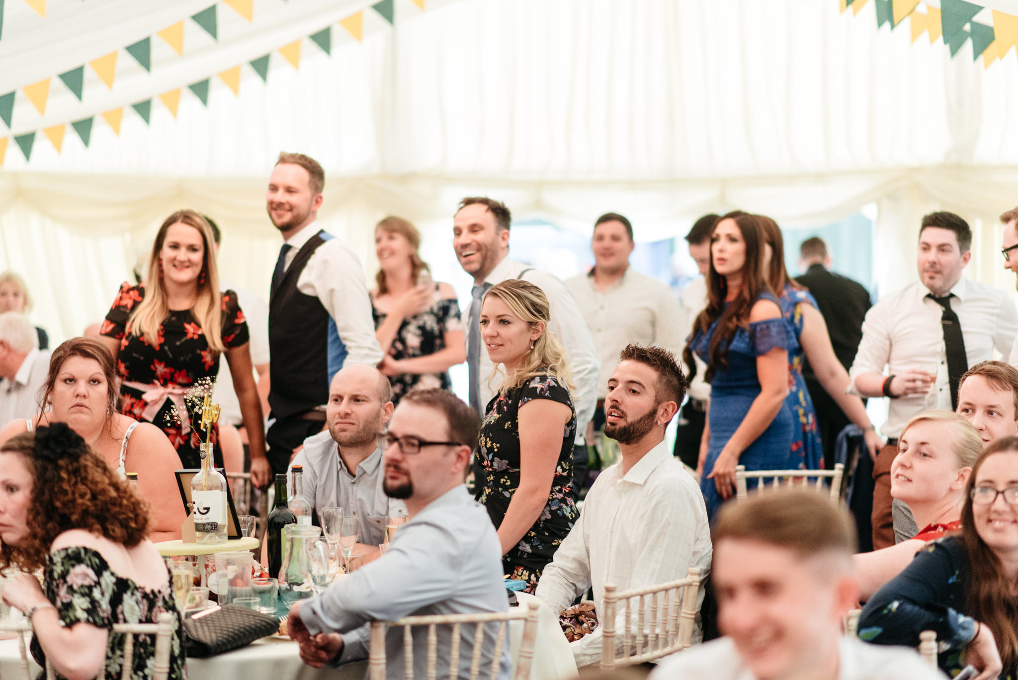 shocked wedding guests at first dance