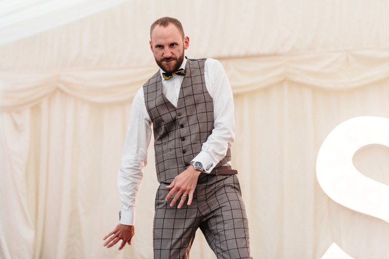 groom busting out some moves