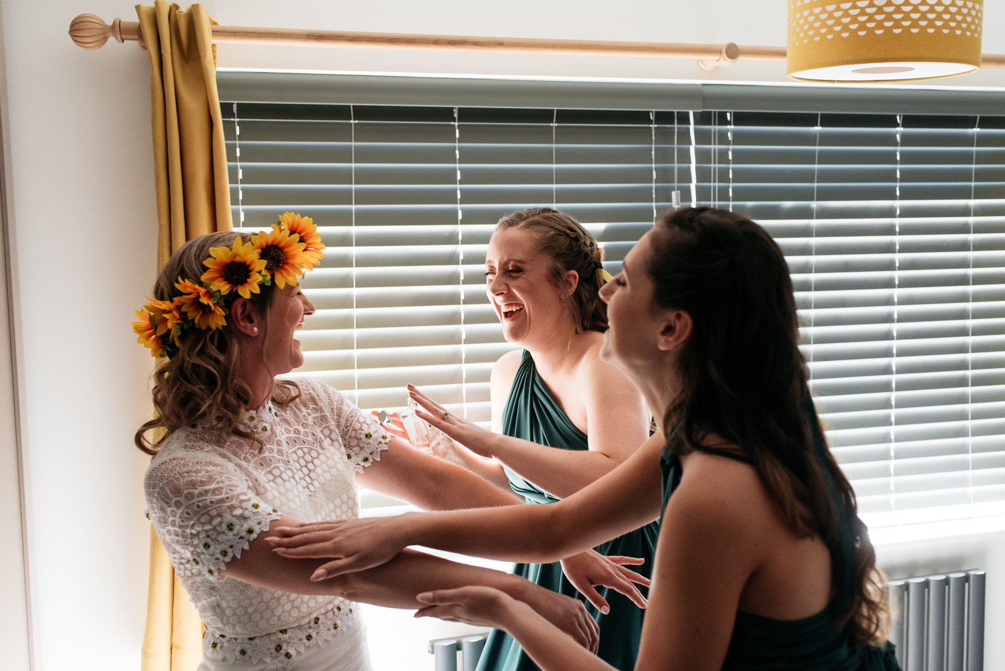 laughing with her bridesmaids