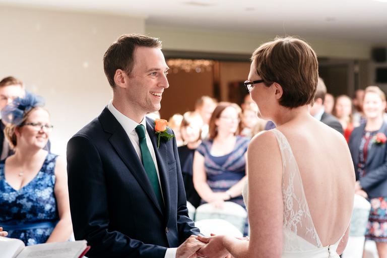 smiling groom at peak edge