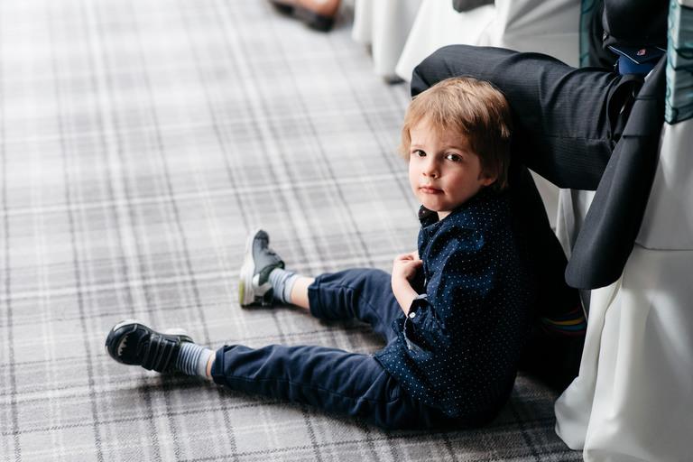 little boy sat on the floor