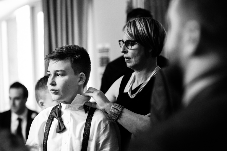 mum sorting out her son's bow tie