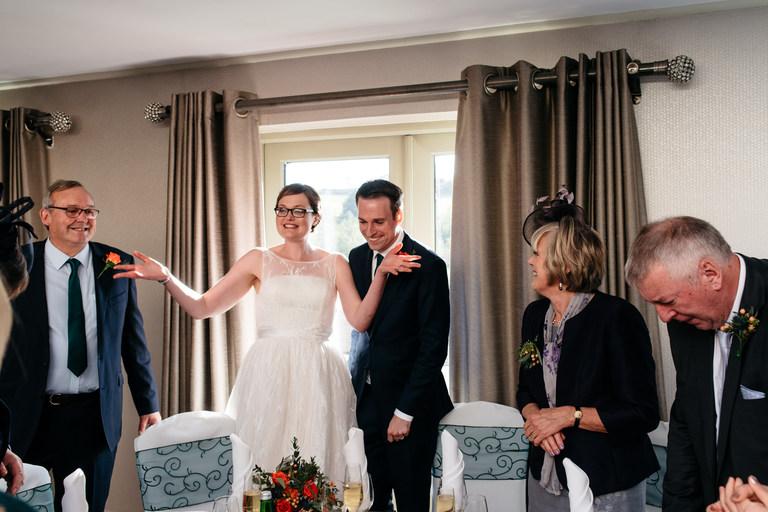 bride telling people to sit down