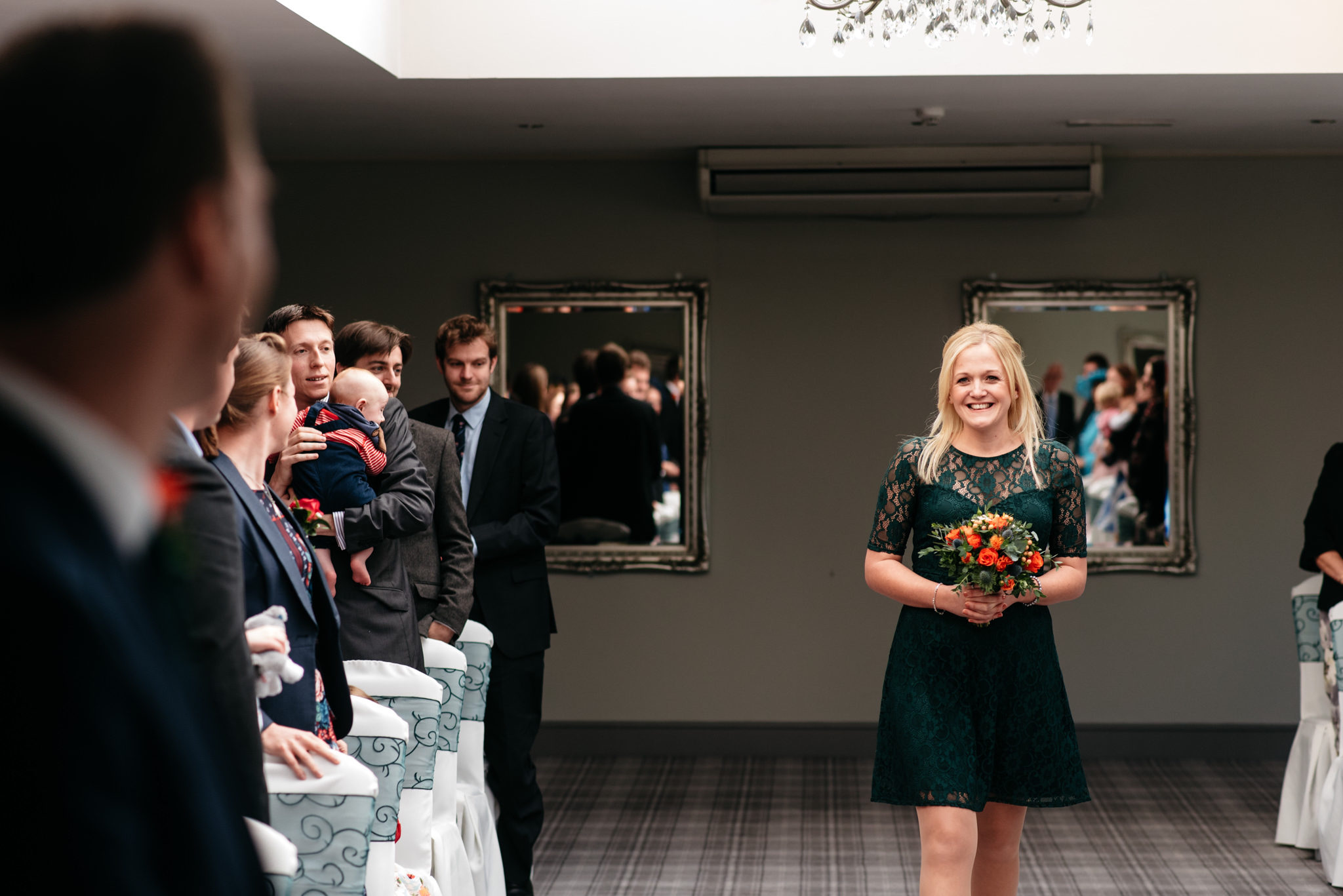 happy blonde bridesmaid in navy blue dress