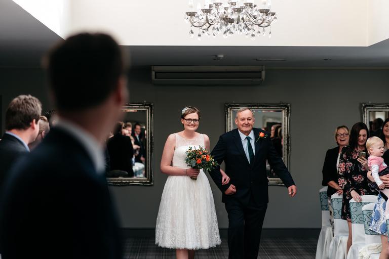 happy bride in shorter wedding dress