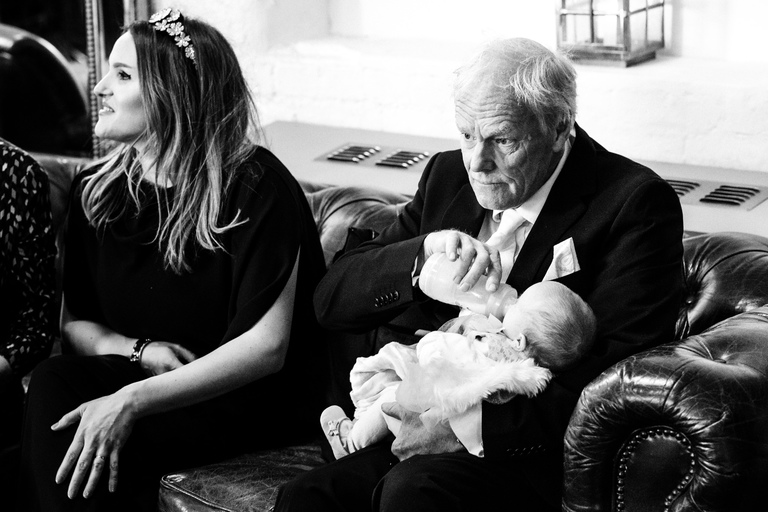 grandpa feeding baby