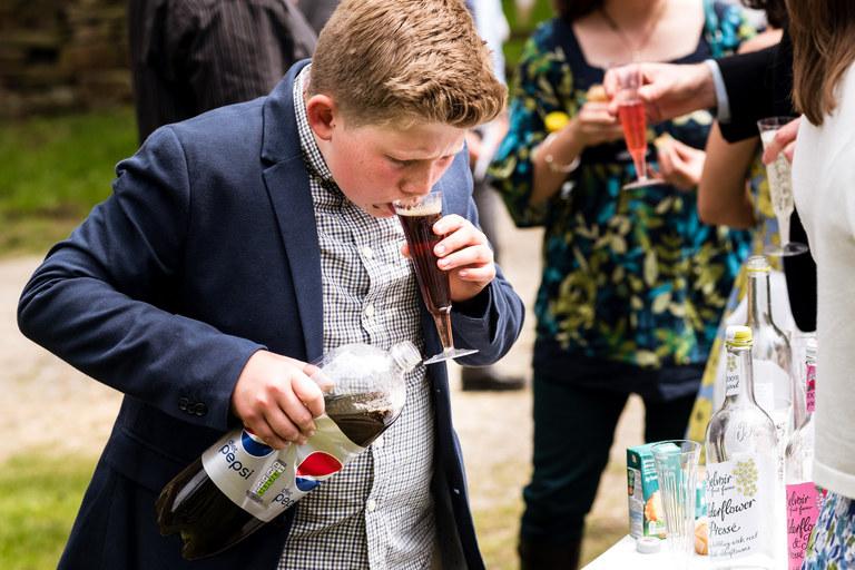 boy drinking from bottle of coke