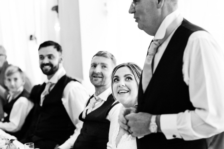 bride watching dad during speech