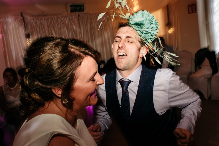guy wearing fascinator whilst dancing