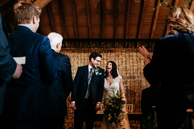 happy laughing couple at grittenham barn