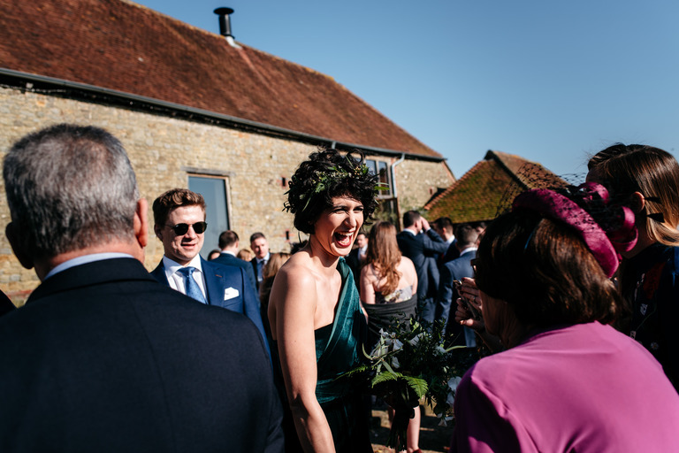 laughing bridesmaid at sunny barn wedding