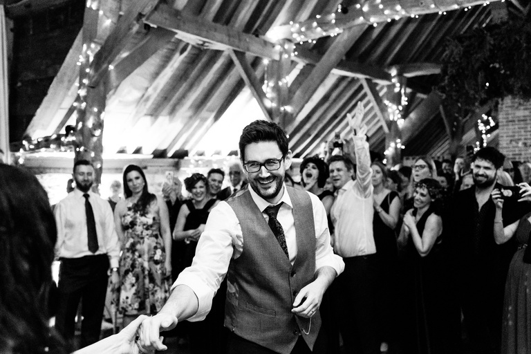 smiling groom during first dance