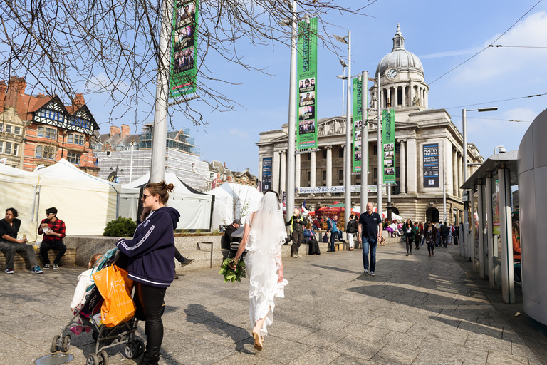bride walking across nottingham square to the council house