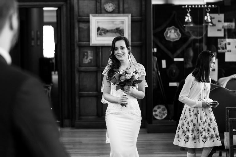 bride walking down the aisle alone