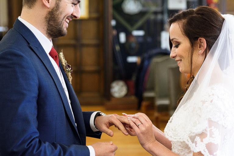 smiling exchange of wedding rings