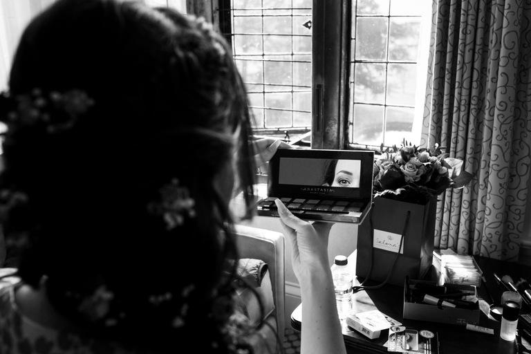 bride's eye in a makeup mirror