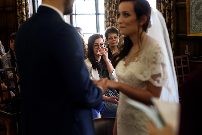 bride's sister crying during ceremony