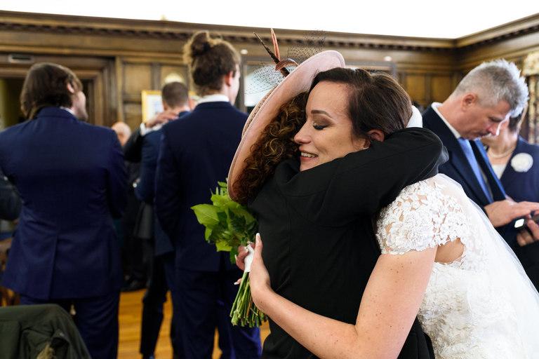 bride hugs after wedding