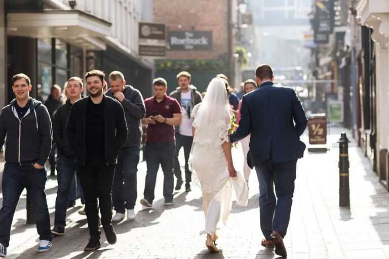 bride and groom walking through nottingham
