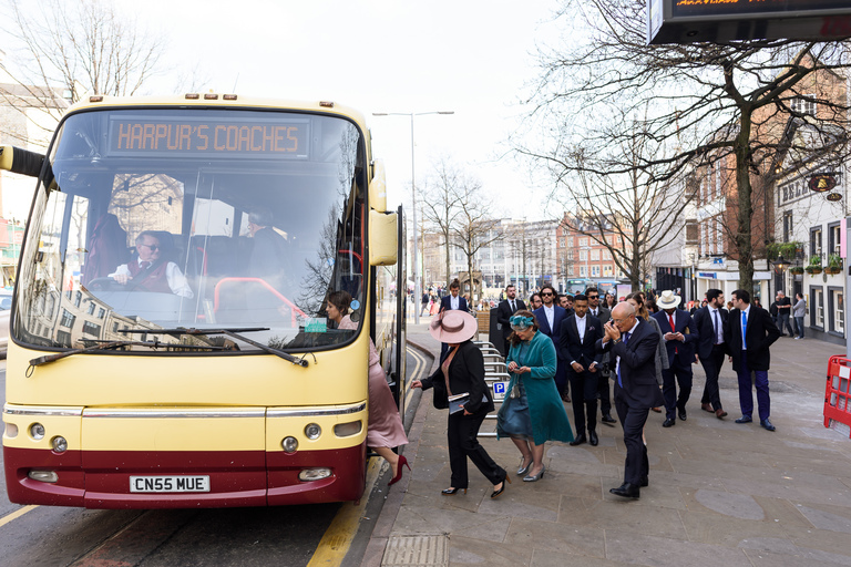 wedding guests getting on a coach to the venue