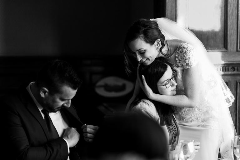 bride comforts her sister