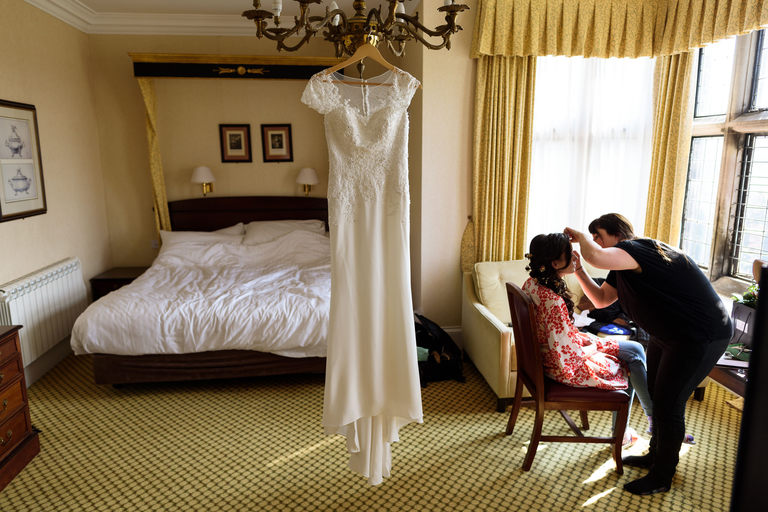 bridal prep with the dress hanging up