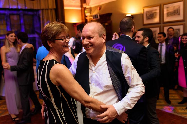 smiling guests dancing
