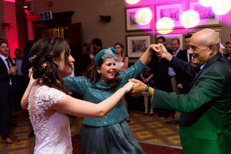 bride dancing with her in-laws