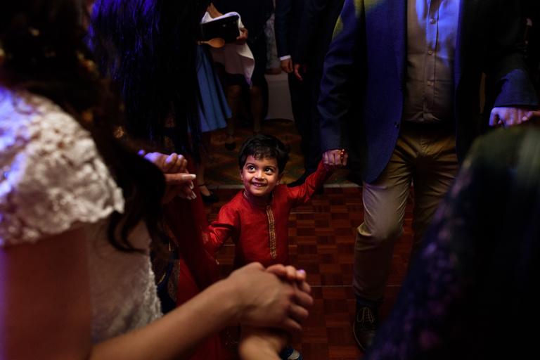 little boy smiling on the dancefloor