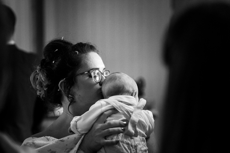 bride kissing baby's head