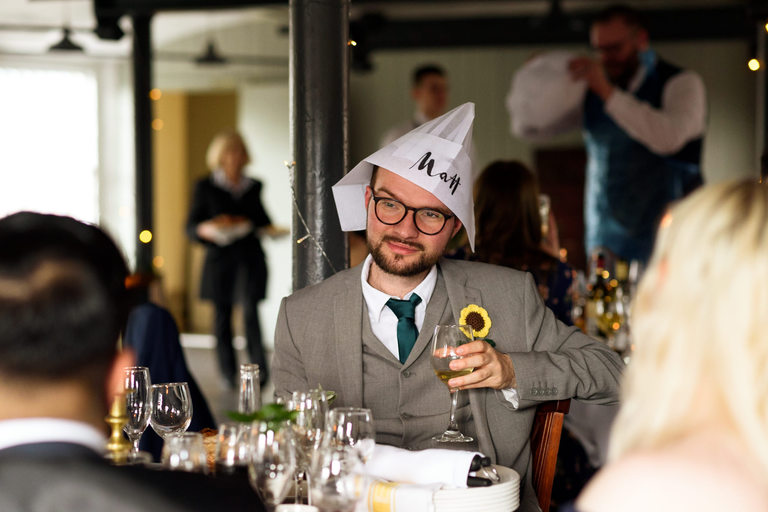 guest wearing chefs hat