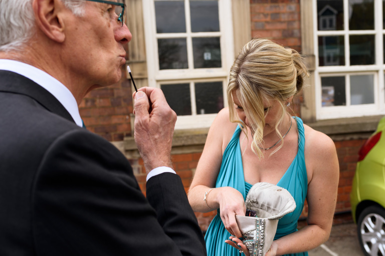 father of the bride joking with makeup